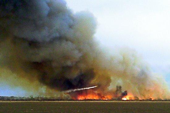Tinnes Spray Plane Douses Prairie Fire East of Lamar-2011 Photo
