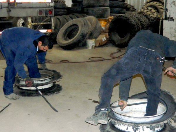 Ace Crew, Stripping Old Tire off Rim