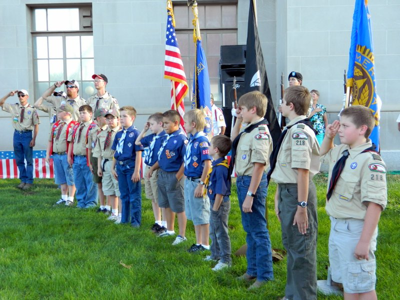 Cub Scouts Salute Honor Guard at Courthouse During First Tribute Observance