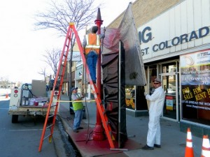 City Crews Shelter Businesses from the Light Pole Paint on Main Street