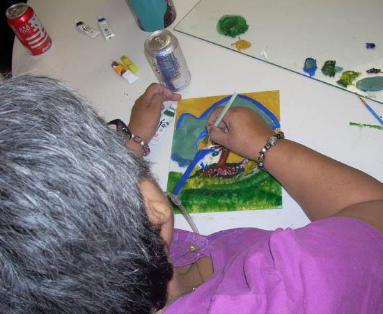 Lamar artist paints a Plexiglas plate to run through the press.