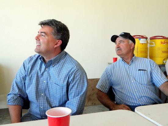 Gardner and Steve Shelton listen to a speaker