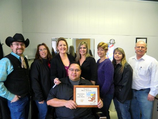 Pictured from left to right:  Axel Thurner – Past President, Lamar Chamber of Commerce, Tera Bender – Vice President, Lamar Chamber of Commerce, Denise Carder – President, Lamar Chamber of Commerce, Mark Encinias – Owner of Mark's Baber Shop, Holly Burton – Honkers, Gaila Austin – Honkers, Sherry Walls – Director, Lamar Chamber of Commerce, Vincent Gearhart – President, Honkers.  (Photo courtesy of Russ Baldwin)