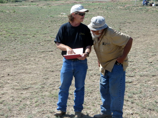 John Carson and Richard Carrillo Inspect Dig Site