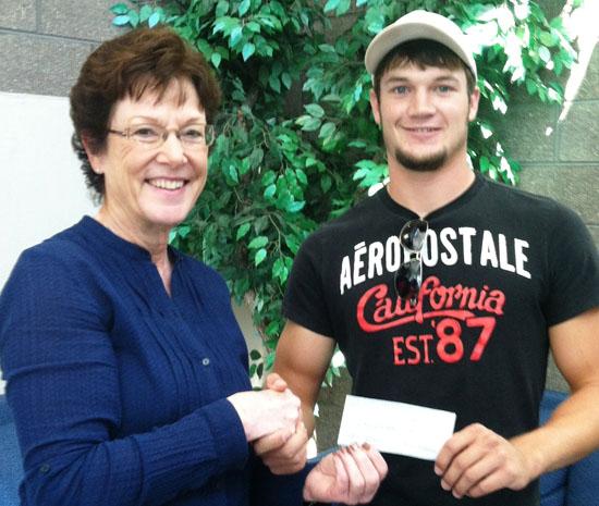 Karen Ketcham presents John Ketcham Memorial Scholarship to Dylan Wahlert