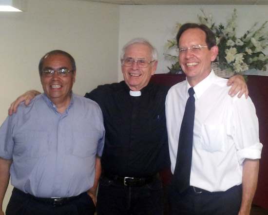 Deacon Henry Wertin (right) with Deacon Allan Medina (left) and Father Charles Sena (center) at a celebration honoring Wertin as he leaves Lamar to begin the process of becoming a Priest.