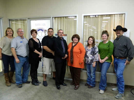 Pictured Left to Right – Denise Carder (Valley National Bank), Vincent Gearhart (Robinson Printing), Lisa Thomas (High Plains Community Health Center), Mark Encinias (Mark's Barber Shoppe), Lance Benninghoff (PCDI Director), Carla Scranton (PCDI Business Manager), Melissa Bohl (Thoughts in Bloom), Kristin Lubbers (Prowers Journal), and Axel Thurner (CF Maier Composites). Photo by Russ Baldwin.