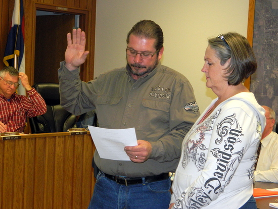 Ron Cook takes his oath of office for the city council