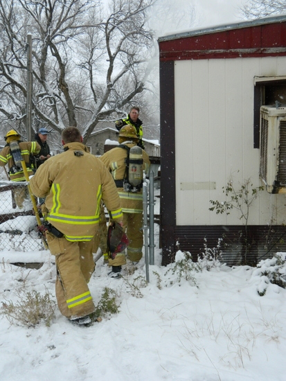 Firemen Enter Trailer Home on West Washington this past Friday