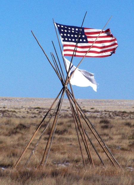 33-Star American Flag, white flag, and lodgepoles at Sand Creek Massacre National Historic Site. Photo Courtesy of the National Park Service.
