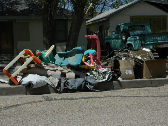 Residents Pile Trash Along Their Curbs for Easy Pick-Up