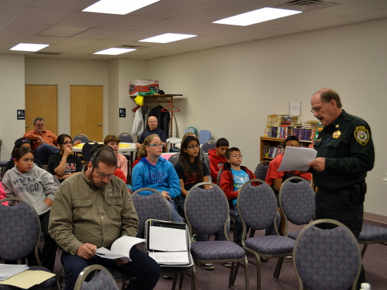 Undersheriff Trowbridge Explains Monthly Report to Holly Students