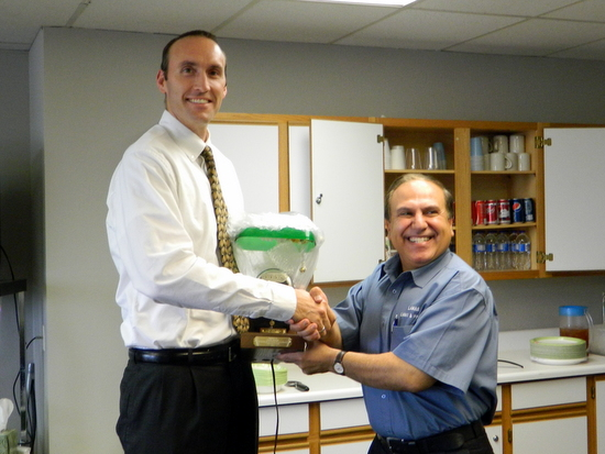 Anderson Receives Commemorative Gift from Houssin Hourieh
