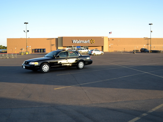 Parking Lot Cleared of Non-Essential Vehicles During Store Search