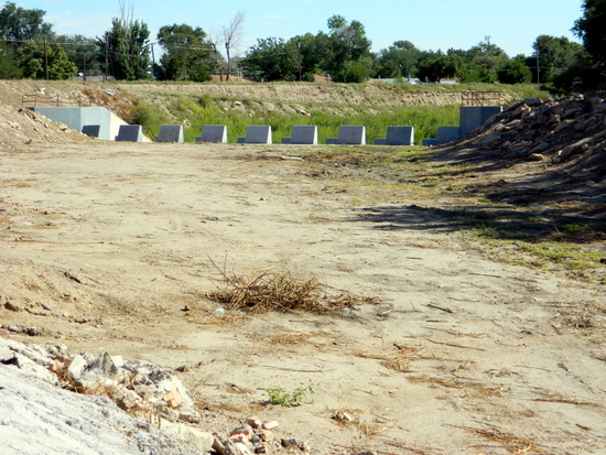 Foliage Removed from Spillway Near Tennis Courts for Improved Water Runoff
