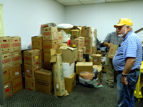 Packaged Supplies for Ft Lyon Residents.  Dick Ramsay at Right