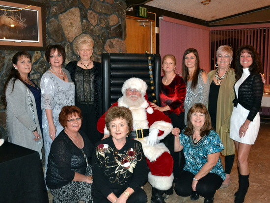 Fantasy Tree Members: Darla Klotz, Jillane Hixson, Toni McPherson.  Standing: Sherry Walls, Lisa Thomas, Lori Morlan, Santa, Lanette Rosetta, Holly Burton, Valerie Baldwin and Melonee Marcum.  Not Pictured: Diane Pool