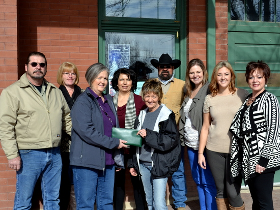 Lopez (R) Receives Check from Lonna Cook (L) at Chamber Offices.  Also pictured L-R - Ron Cook, Vickie Dykes, Michelle Crown, Mark Carrigan, Jenna Davis, Lisa Carder, Lisa Thomas