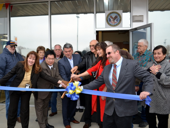 Ribbon Cutting for the VA Clinic L-R: Cheryl Kester Clinic Mgr, Dr. Lithium Lin Deputy Chief of Staff, Congressman Cory Gardner, Commissioners Schnabel and Buxton-Andrade and Jeremy Miller-Local VA Representative