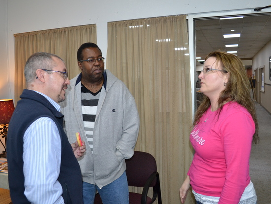 Lance Benninghoff Speaks with Lamar City Councilman Anne Marie Crampton at PCDI Office. KVAY Announcer Travis Williams in Background