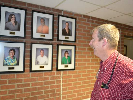 Dr. Smith Studies New Photograph Wall