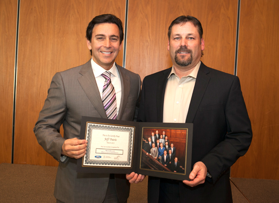 Travis Receives Presentation from Mark Fields, President and CEO of Ford Motor Company