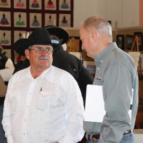 Bill Gray of Ordway, left, visits with Colorado Beef Council Director Fred Lombardi. The cattlemen's meeting gave ranchers a chance for one-on-one time with industry leaders