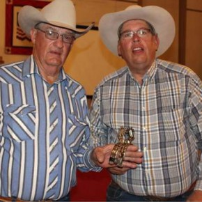 Don Albert, left, presents the hand-made spurs to high bidder Pat Karney after the Bent-Prowers Cattle & Horse Grower's banquet on April 11.