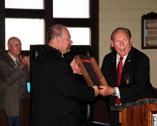 Grand Exalted Ruler, John Amen presents the 100 Year Award Plaque to Lamar Exalted Ruler Cary LaCost.