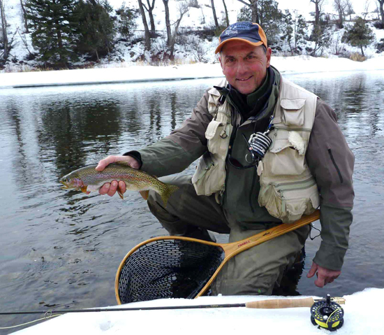 Dave Parri of Hot Sulphur Springs, holds a rainbow trout he caught last winter on the upper Colorado River. The rainbow is a whirling disease resistant fish developed by Colorado Parks and Wildlife scientists.
