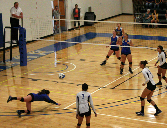 LCC defensive specialist Andreia Bomfin (Brazil) dives for a ball in action against Cisco College.