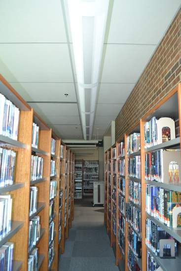 Book Shelves Were Relocated with Relation to Lights to Accommodate Patrons Needs