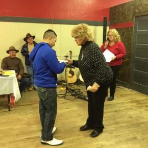 Pat Johnson presents award to Alan Flores.