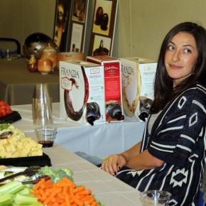 Volunteer Megan Grett mans the hospitality table.