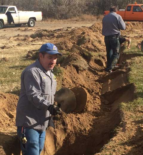 "LCC Plant mechanics Kurt Nieschburg and Kurt Milberger help get the future construction site ""shovel ready"" for work in early 2016."