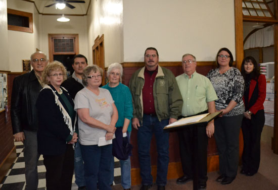 Commissioners Present Check to Holly Library Board