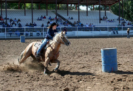 Melanie Roman in Barrel Race Competition